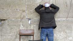 Man praying in the Western Wall.  Jerusalem. Israel Stock Footage