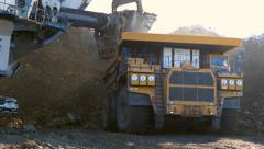 4K Stock Video Footage Mining Dump Truck loading excavator heavy track Stock Footage