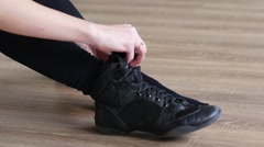 Dancer girl dress black shoes sitting on the floor Stock Footage