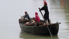 Fishermen row traditional fishing boat in Sundarbans National park. Stock Footage