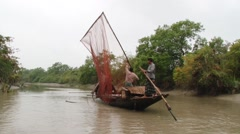 Stock Video Footage of Fishermen do fishing with otters in Sundarbans National park.