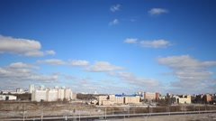 Beautiful clouds float in the sky rapidly over the city Stock Footage