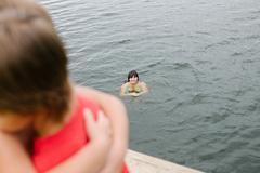 Family time at the lake on hot summer day - stock photo