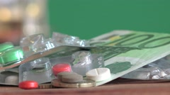 Capsules tablets are on  table one hundred euros and copper coins, 4k Stock Footage