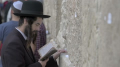 Orthodox jews praying in the Western Wall. Jerusalem. Israel Stock Footage
