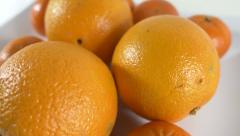 4K - Some oranges on a plate Stock Footage