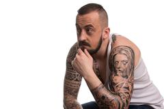 Man With Tattoo And Beard On White Background - stock photo