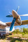 Turbines of turboprop aircraft An-12 at an abandoned aerodrome - stock photo