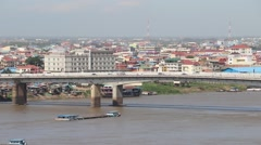 Japanese Bridge cars crossing pan from Phnom Penh with boats Stock Footage