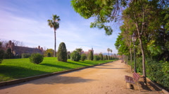 Spain sunny day barcelona ciutadella park walking road 4k time lapse Stock Footage