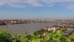 Pan of Phnom Penh and Japanese Bridge with balcony plants 2 Stock Footage