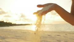 SLOW MOTION: Female playing with white sand on exotic beach Stock Footage
