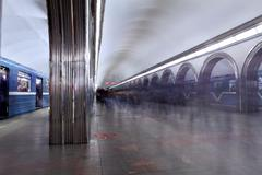 Flow of passengers on platform metro station at rush hour. Stock Photos