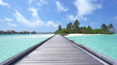 SLOW MOTION: Water villas in front of exotic white sand beach Stock Footage