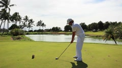 Golfer hit is tee shot from the tee box in hawaii Stock Footage