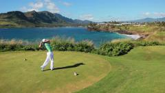lefty golfer hit is par 3 shot in hawaiian paradise - stock footage