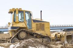 Small Bulldozer On A Highway Jobsite Stock Photos