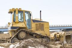 Small Bulldozer On A Highway Jobsite - stock photo
