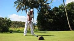 lefty golfer hit long drive shot in hawaii - stock footage