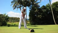 Stock Video Footage of lefty golfer hit long drive shot in hawaii