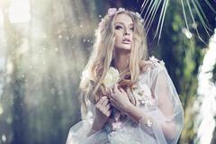Gorgeous delicate woman with the sun beams in the background Stock Photos