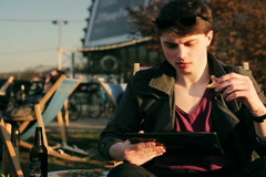 Student eating pizza in outdoor bar and doing serious look to the camera Stock Footage