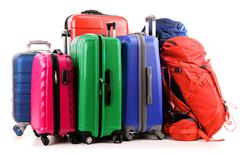Luggage consisting of large suitcases and rucksack isolated on white. Stock Photos