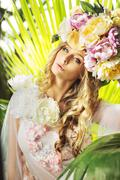 Pretty lady with the flowery hat - stock photo
