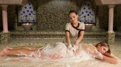 Girl enjoys of turetskim massage in hammam Stock Footage
