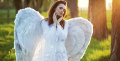 Satisfied angel heated by the sun beams - stock photo