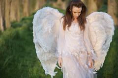 Alone angel walking in the forest Stock Photos