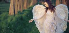 Sad angel in the bosom of nature - stock photo