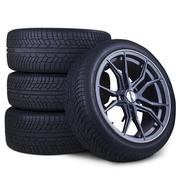 Four racing tires isolated Stock Photos