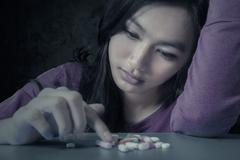 Female student with pills Stock Photos