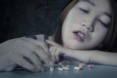 Female student addicted narcotic Stock Photos