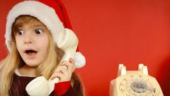 Little girl vintage telephone christmas hat - stock footage