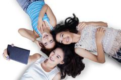High angle view of teenage girls - stock photo