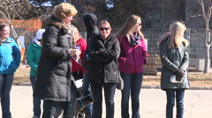 People out on a cold day dressed in winter clothing and coats Stock Footage