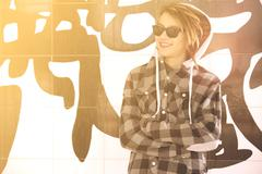 Young guy  with sunglasses and rasta hair warm filter applied Stock Photos
