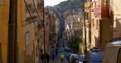 Barcelona hill street sunny day life 4k spain Stock Footage