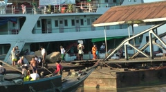 Men unload a riverboat,Yangon,Burma Stock Footage