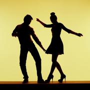 Two silhouettes on the dance-floor - stock photo