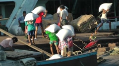 Men unload a riverboat, a closer look,Yangon,Burma Stock Footage