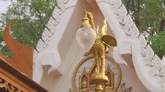 Street lamp at the Wat Intharawihan in Bangkok, Thailand Stock Footage
