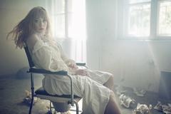 Portrait of the young pale woman in the old hospital - stock photo