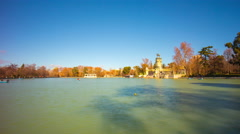 Madrid sun light retiro park pond panoramic view 4k time lapse spain Stock Footage