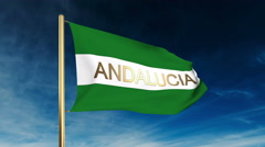 Andalucia flag slider style with title. Waving in the wind with cloud background Stock Footage
