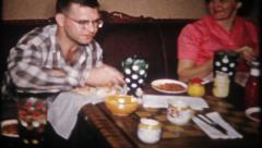 1948 - lunch on the card table in the living room - vintage film home movie Stock Footage