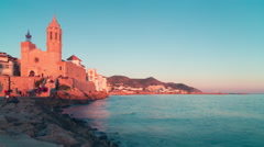 Spain sitges sunset church bay view 4k time lapse Stock Footage