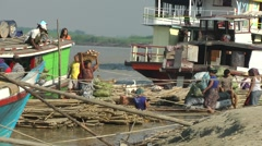 Unloading a riverboat,Mandalay,Burma Stock Footage